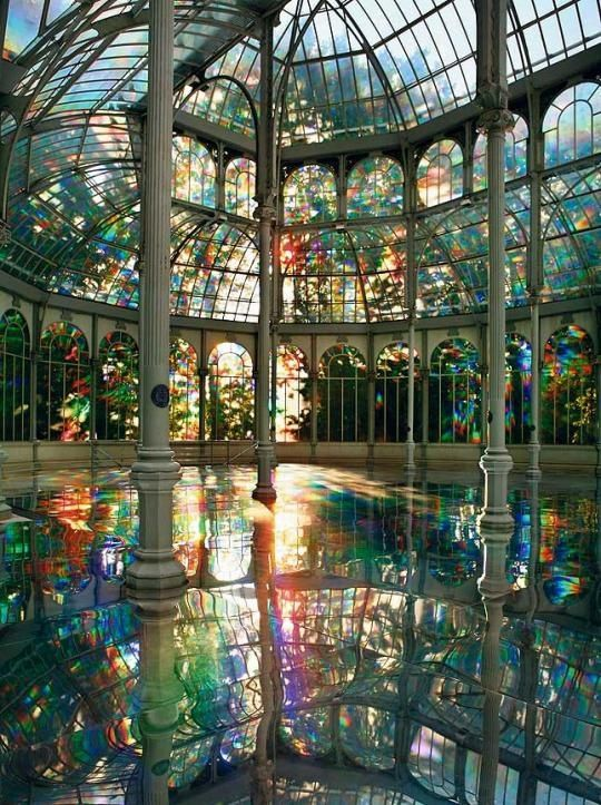 """To Breathe—A Mirror Woman,"" 2006 Diffraction grating film, mirror, and sound performance piece by the artist from ""The Weaving Factory,"" 2004. Installation at The Crystal Palace, Madrid. Photo by..."