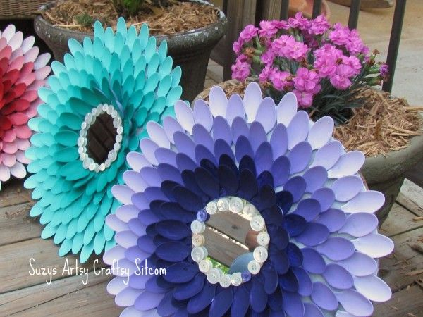 Plastic Spoon Chrysanthemum's(Large big ones)made on a frame with a mirror in the center...