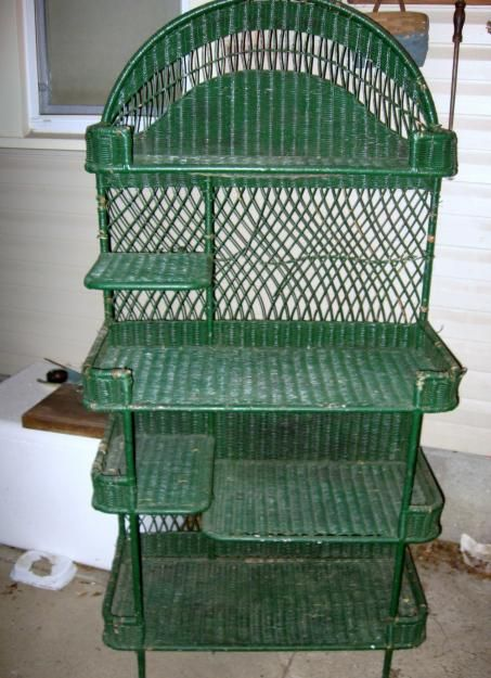 Vintage wicker plant stand.  I would love to find one like this and repaint it.