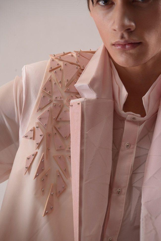 Pink jacket with embellished shoulder using studded wooden fragments for…