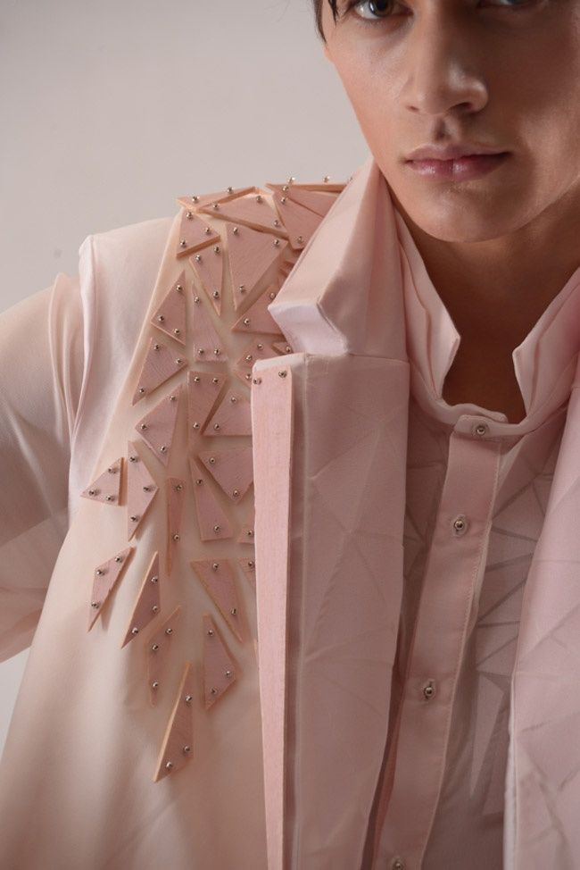 Pink jacket with embellished shoulder using studded wooden fragments for texture; geometric fashion detail // Yung Wong
