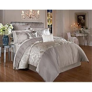 totally love all the white furniture.  not so much the silver bedding though.  just everything else!  for MY bedroom