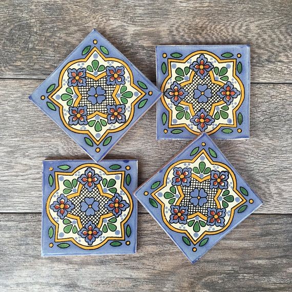 Mexican tiles have been lovingly turned into a beautiful set of coasters for your home! These are authentic tiles made in Mexico. The addition of cork on the bottom make them scratch-proof for your table tops or other surfaces. They are each 4 wide x 4 long, and roughly 0.5 tall,
