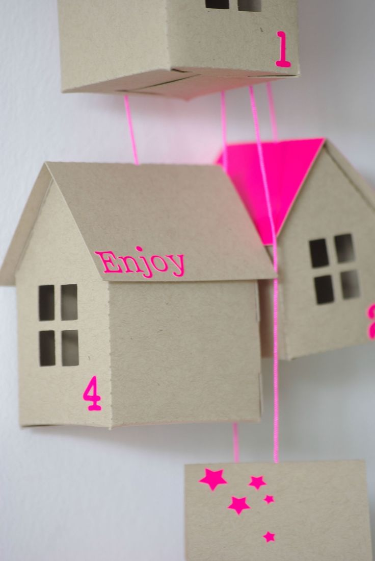 i love the combo of raw material (cardboard) w/ neon> this is an advent calender but i just love it for decor