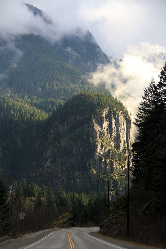 Stunning view of cliffs, lush trees and misty clouds from the highway through the Fraser Canyon, BC