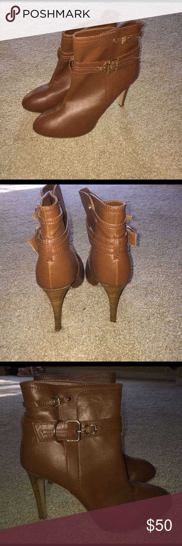 Never been worn super stylish leather boots. Tan leather boots that have never been worn. Gold buckle on the sides. Size 10 but fit very narrow. My feet were too wide for them. Colin Stuart Shoes Ankle Boots & Booties