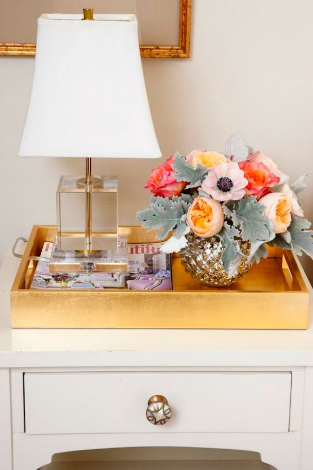 Dress up a side table or coffee table with a chic golden tray.