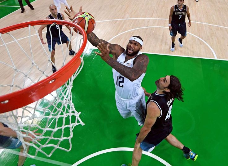 USA center Demarcus Cousins (12) shoots the ball against Argentina power forward Luis Scola (4) during the men's basketball quarterfinals in the Rio 2016 Summer Olympic Games at Carioca Arena 1.