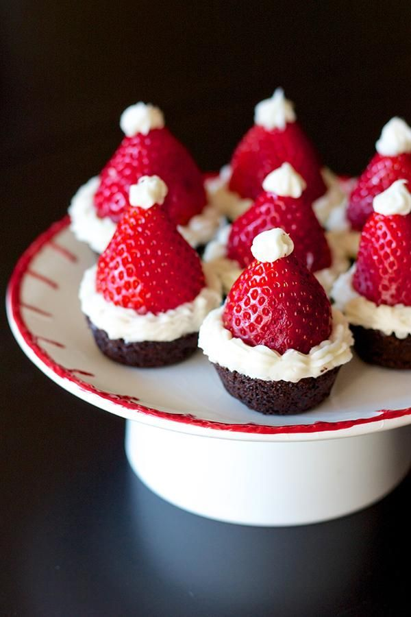 Santa Hat Brownie Bites!1 box brownie mix 24 small strawberries 2 cups white chocolate chips - Preheat oven to 350 degrees and grease 1 mini-muffin pan - Prepare brownie mix according to box's instructions and fill cavities 3/4 of the way fullBake for 25 minutes, or until cake tester comes out clean - Let brownies cool and use this time to hull and clean the strawberries - Once cool, place strawberries upside down onto brownie bites - Melt white chocolate in a double boiler and transfer...