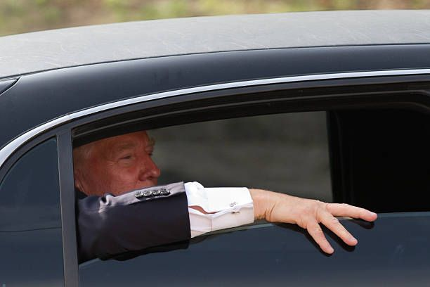 Donald Trump looks out the window of his limousine after visiting Newick's Lobster House on April 27 2011 in Dover New Hampshire Trump is testing the...