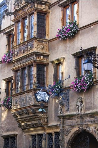 Renaissance style double storey projecting Oriel bay windows corbeled (or cantilevered) in the town of Colmar - 'Maison des Tetes' house of the heads