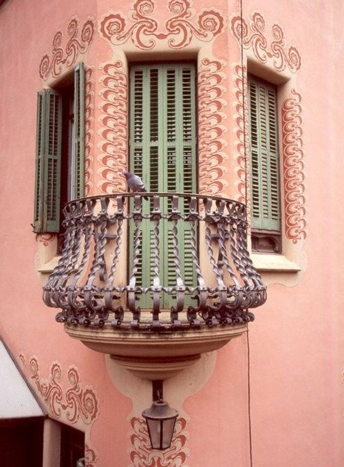 Love this gorgeous little pink balcony with green shutters!
