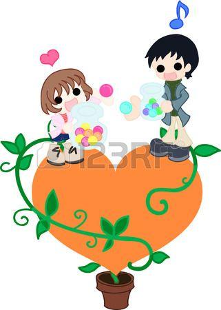 Sul cuore arancione, un padre e sua figlia cambia caramelle colorate vicenda Archivio Fotografico - 26034790