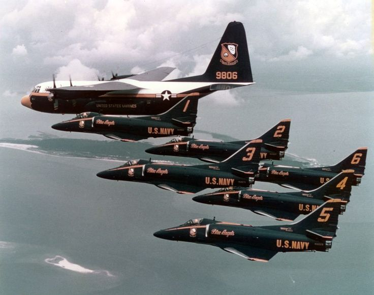 """Douglas A-4 Skyhawk 60th Anniversary. A-4F Skyhawks of Blue Angels display team, fly in formation with """"Fat Albert"""", the team's Lockheed C-130 Hercules transport."""