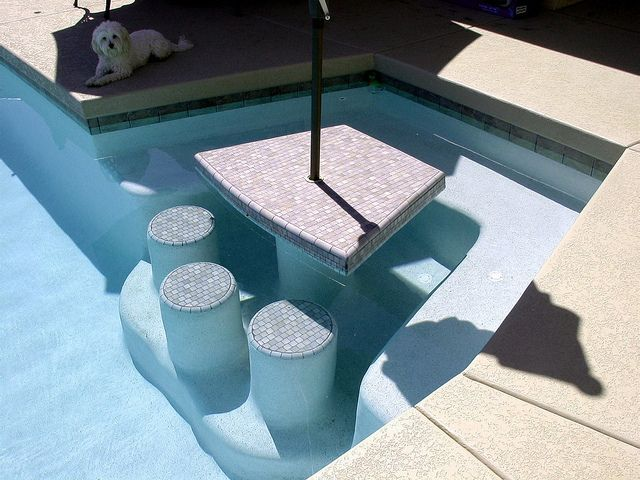 Eat in the pool with this sunken booth-style dining table, then keep swimming for more summer fun!