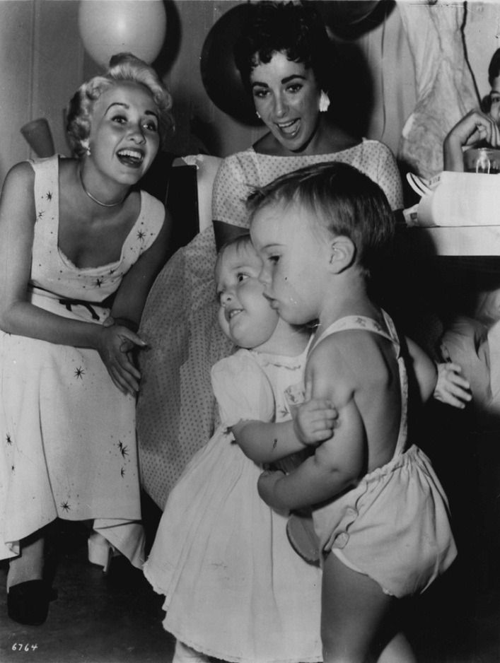 Jane Powell and Elizabeth Taylor with their children, 1955