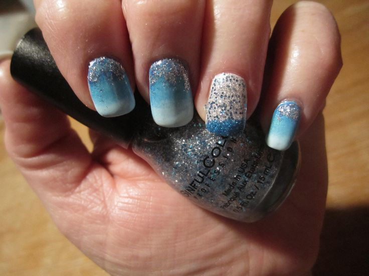 Tri-color ombre in blue...silver glitter by the nail beds...ring finger base coated in white, topped with 'Ice Dream' and tip dipped in blue nail glitter