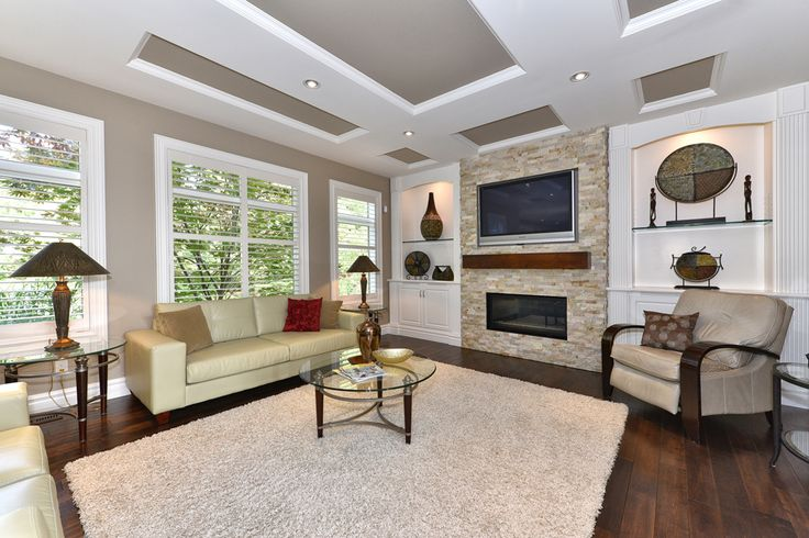 Great Room with Custom Built-in Shelving beside feature Fireplace #newhome #customhome #design #fireplace #model