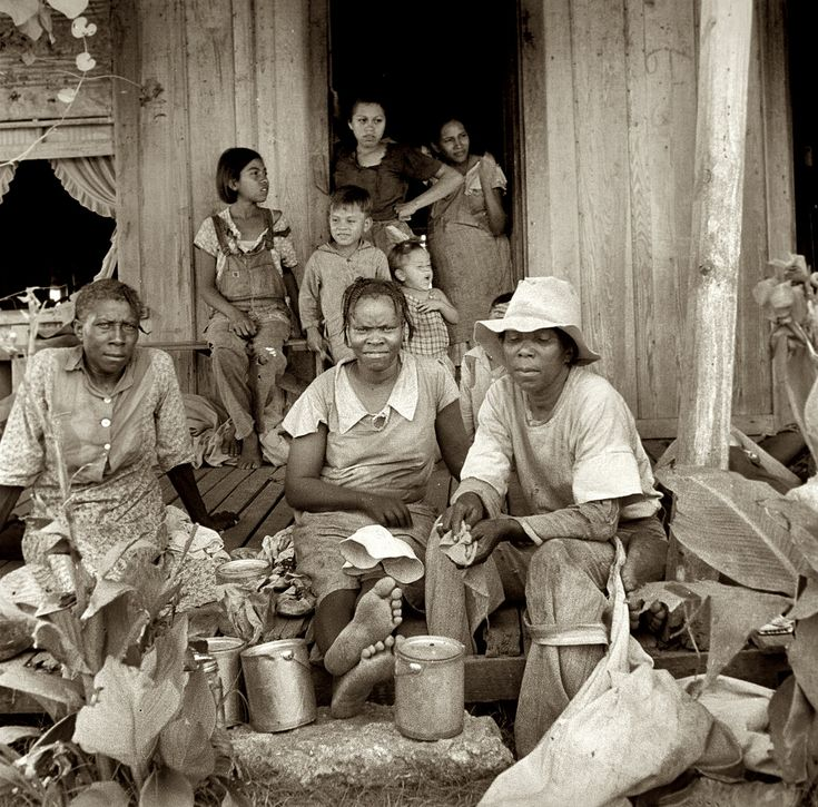 In From the Fields: August 1936. Migrant cotton pickers at lunchtime. Near Robstown, Texas. Medium-format nitrate negative by Dorothea Lange.