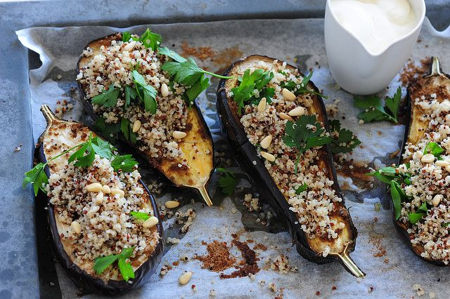 Spiced Eggplant with Yoghurt & Quinoa     Enough for 2     2 large eggplant (aubergine)     2 teaspoons ground coriander     150g (5oz) quinoa     1 bunch flat leaf parsley, leaves picked     6-8 tablespoons natural yoghurt     large handful pine nuts, toasted
