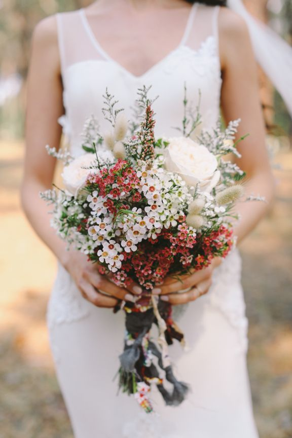Love the elegant, simple dress and the bouquet of Australian wax flowers