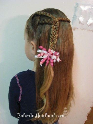 little girls hair...3 braids into 1.