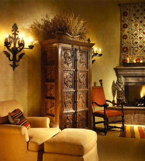 Spanish style interior with dark wood against yellow walls and furniture. Appliqué quilt wallhanging