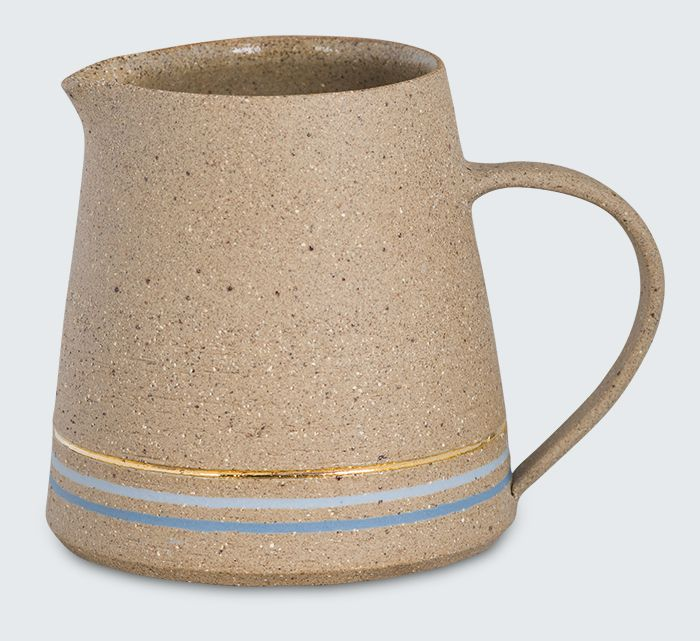A stunning stoneware jug with lovely gold and blue ring detailing. Sophie Moran is a Melbourne based ceramicist whose work treads the fine line between functional, conceptual and ornamental ceramics.