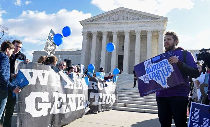 Pro-abortion rights protester Sarp Aksel of New York City, right, and anti-abortion protesters, left, rally outside the Supreme Court in Washington, Wednesday, March 2, 2016. The abortion debate is returning to the Supreme Court in the midst of a raucous presidential campaign and less than three weeks after Justice Antonin Scalia's death. The justices are taking up the biggest case on the topic in nearly a quarter century and considering whether a Texas law that regulates abortion clinics…