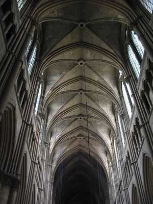 The Rib Vaulting (Gothic)-These advances in vaulting allowed for the addition of more windows high up in the building and also led to other additions to the higher reaches of a church such as the clerestory and the triforium where also additional space was provided for visiting saints and angels.  Early Gothic buildings commonly display ribbed vaulting made of stone for the support of the weight of a wooden ceiling.