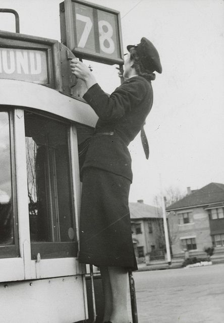 1942-ca. 1943  Shows conductress altering destination number on tram. by State Library of Victoria Collections, via Flickr.  Richmond tram, Melbourne Australia
