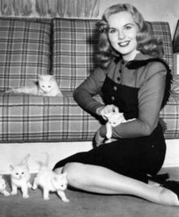 Deanna Durbin, Canadian singer and actress, with her kittens.