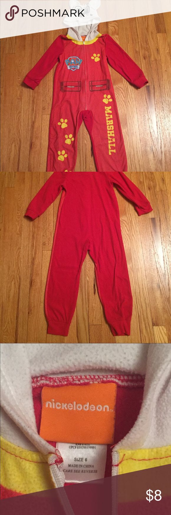 Fleece Paw Patrol Marshall 1 piece zip up pajamas Fleece Paw Patrol Marshall one piece zip up pajamas, size 6. These pajamas feature a front zip and hood with Marshall's dog ears. Retails new for $14.94 at Walmart. Worn a few times.  **Offers welcome and bundles receive a discount. Smoke and pet free. Gently used clothing is in excellent used condition with no flaws or damage. Pajamas