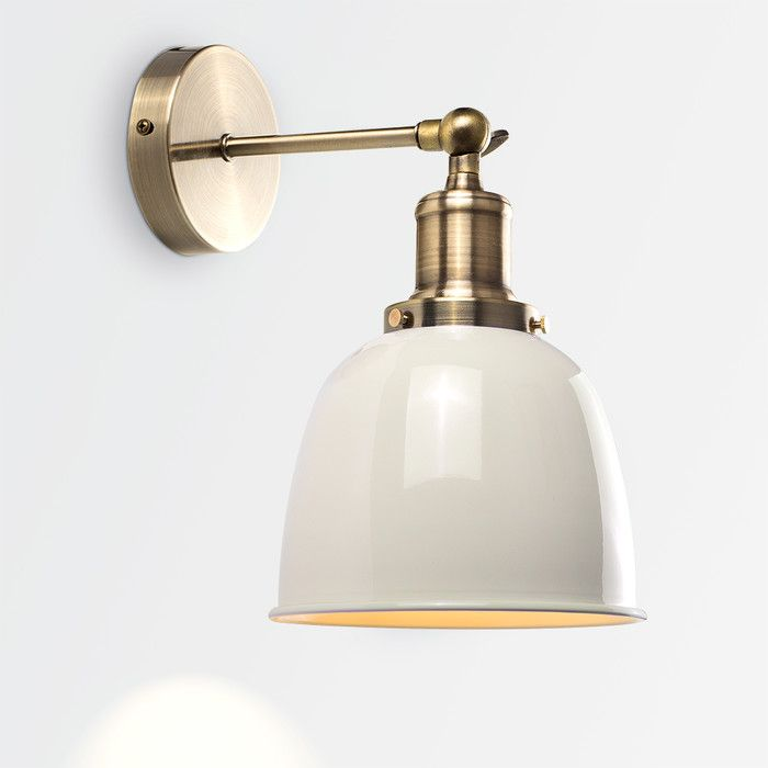 Beautiful industrial style LED wall light fitting in an antique brass effect finish. This sleek and stylish lamp is a great way to add a contemporary edge to any room in your home. It features an adjustable knuckle joint bracket to allow you to direct the light where needed. Comes supplied with a 4W LED vintage style bulbs which give off a warm white light. The intricate filament adds to the design of the light.