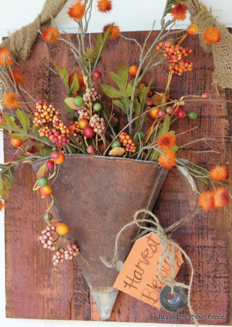 LOVE this rusty oil funnel turned front door wreath! / front door decor at Beyond The Picket Fence http://bec4-beyondthepicketfence.blogspot.com/2013/08/fall-rust.html