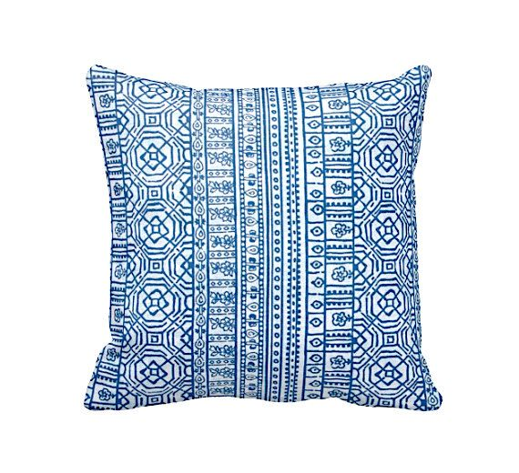 DESIGN, TEXTILE, CRAFTSMANSHIP & CARE This pillow cover features a cobalt blue and white printed pattern that is continuous on both front and