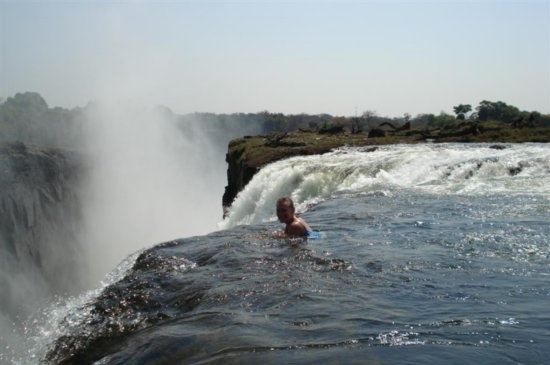 They're safe enough, this is the Devil's Pool on Victoria Falls. Would love to see this...probably wouldn't swim.