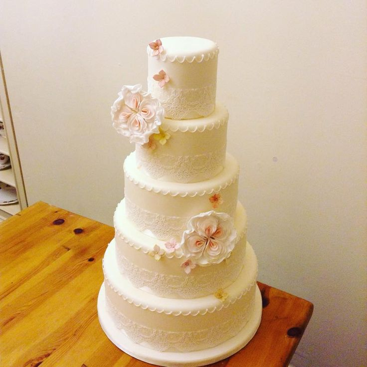 Large Rose detailed wedding cake with beautiful lace finish @savethedatecollective info@savethedatecollective