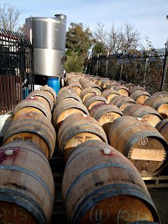 Topping wine barrels on a cold spring day