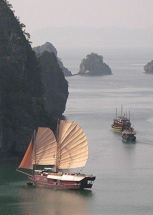 Ha Long Bay, Vietnam. A few of the best days of my travel life were spent on one of these boats. Go.