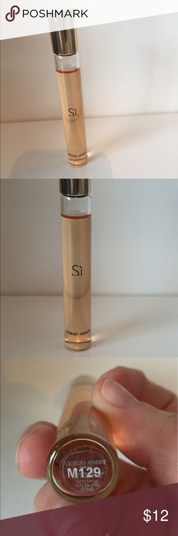Si by Gorgio Armani rollerball Si perfume rollerball. Gorgio Armani fragrance. Used a handful of times. Smells nice but bothers my sensitive allergies. gorgio armani Makeup