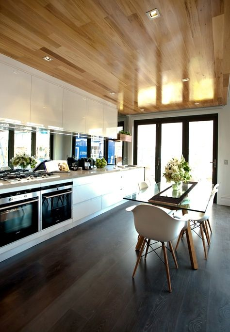 Love the clean lines of this stunning kitchen design, the wooden ceiling brings warmth #kitchen