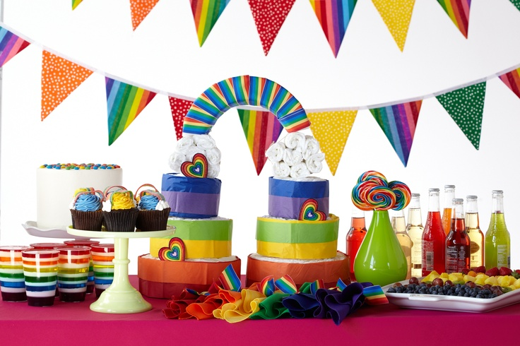 Lovely Rainbow Themed Baby Shower. A Colorful Display Of Swirl Lollipops, Fruit  Salad And