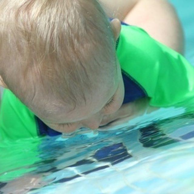 Swimming games help teach a baby to be more comfortable with having her face in the water.