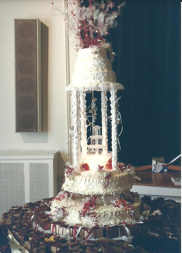 Sam and I had a 5 foot tall wedding cake to celebrate our day...Made by Maridel and Leslie via Winnetka Cake and Pastry Shop, now Mrs. A's Cupcakes and Cookies at the Pickwick