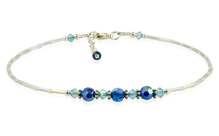 This beautiful handmade Ocean Blue Crystal Beaded Anklet combines iridescent clear and white, aqua and capri blue Swarovski crystals, and sterling silver. Created with iridescent tube beads and white