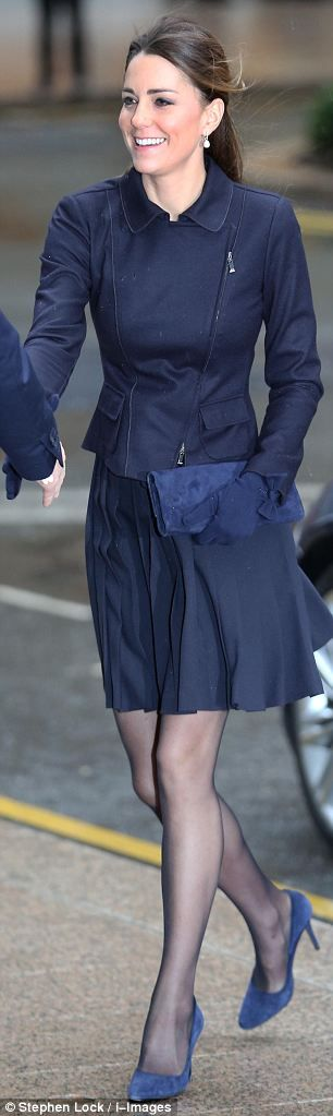 11/20/13. Her pleated skirt was by Orla Kiely skirt and her matching navy jacket was by MaxMara