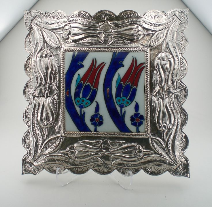 Silver square Wall Mirror with porcelain tulip flowers.