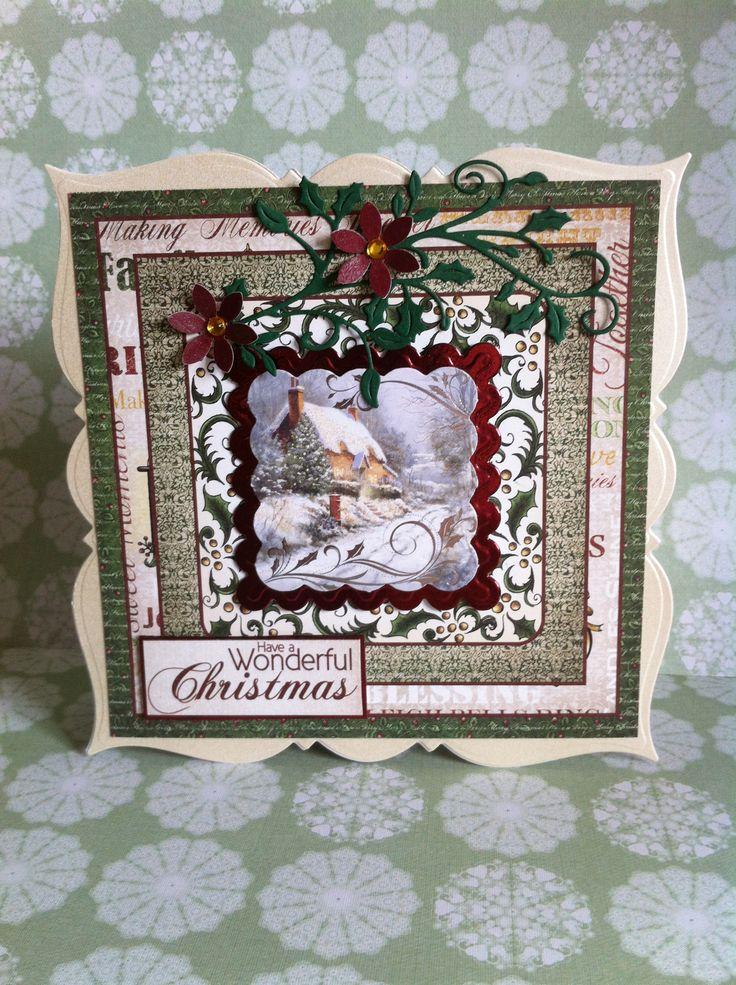 Festive Christmas papers, Cheery Lynn Holly flourish, XCut flower punch, Go Kreate frilly frame #7 base card.