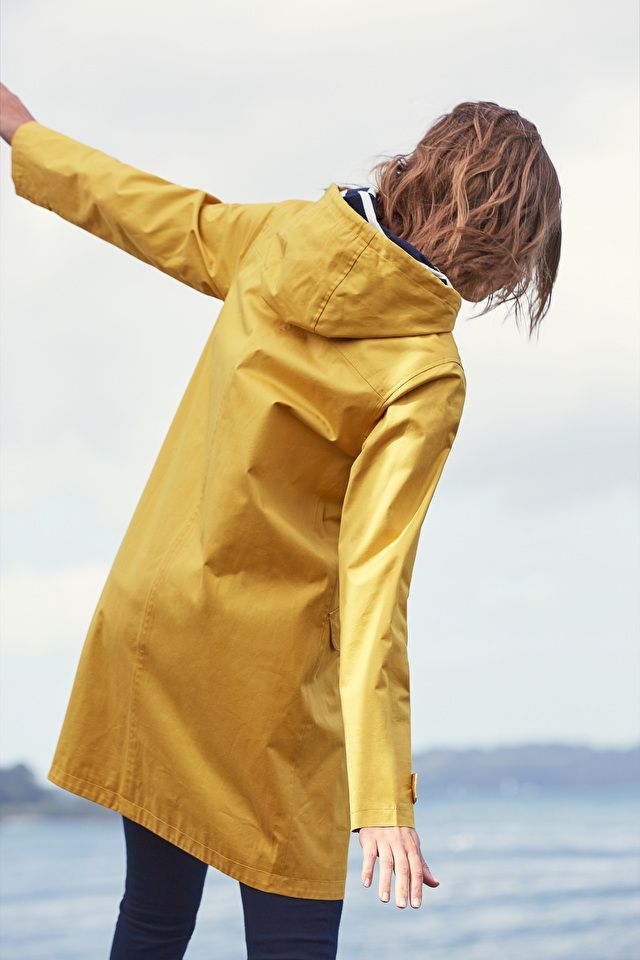 Inspired by traditional fishermen's macs, this women's raincoat is crafted from waterproof, windproof & breathable organic cotton with a Breton stripe lining.  #SeasaltComfortAndJoy